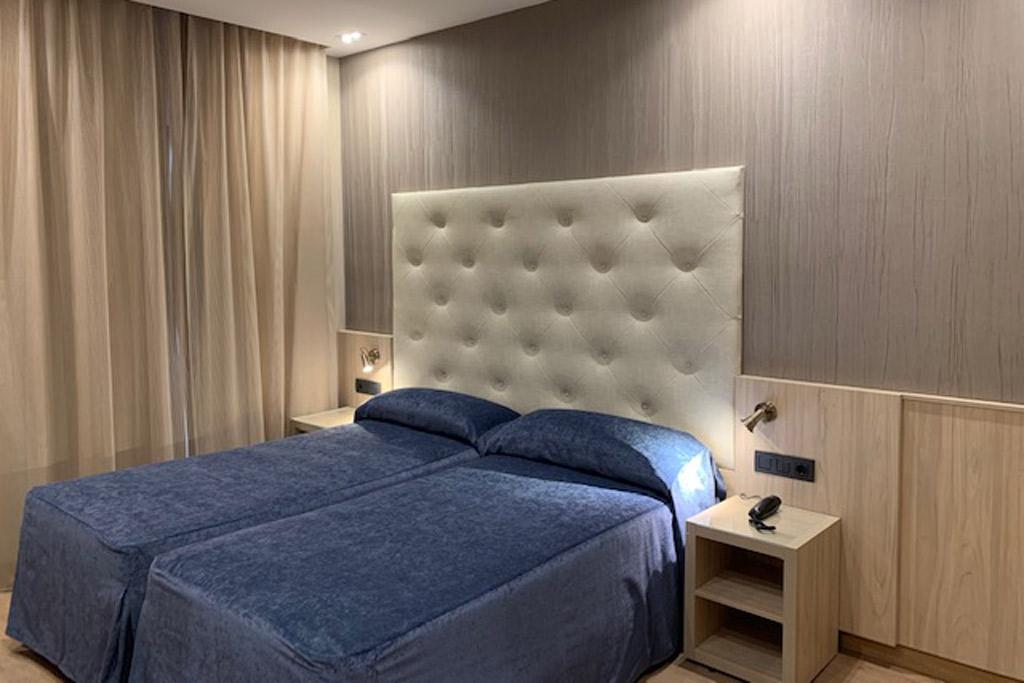Hotel-Rialto-Poliol-Habitacion-camas